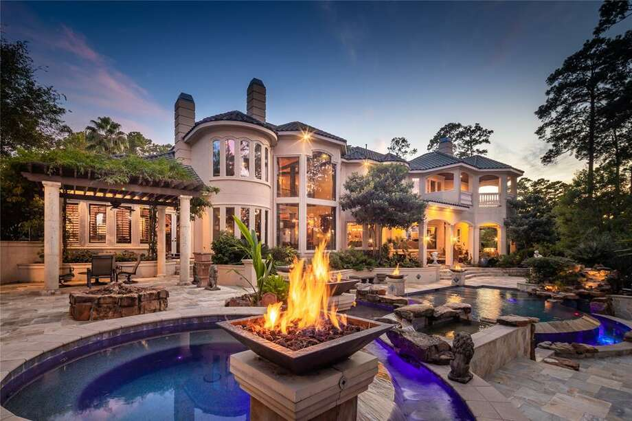 Live life on the water at this newly-listed, $3 million Kingwood home that boasts the largest boat house on Lake Houston. Located at 32 Tahoe Shores Court, the 8,267-square-foot mansion offers five bedrooms, four full bathrooms, three half bathrooms as well as a media room, basketball court, pool and spa, five-car garage and casita. Photo: Houston Association Of Realtors