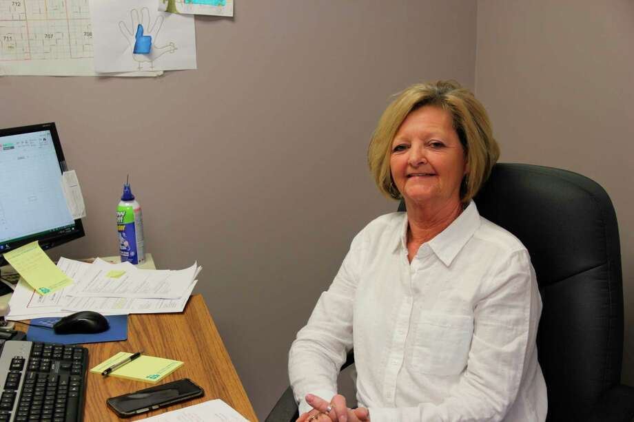 Mary Krohn in her office on Soper Road in Bad Axe. Krohn has been coming up on 30 years with the dispatchers of Huron County Emergency Services. (Robert Creenan/Huron Daily Tribune)