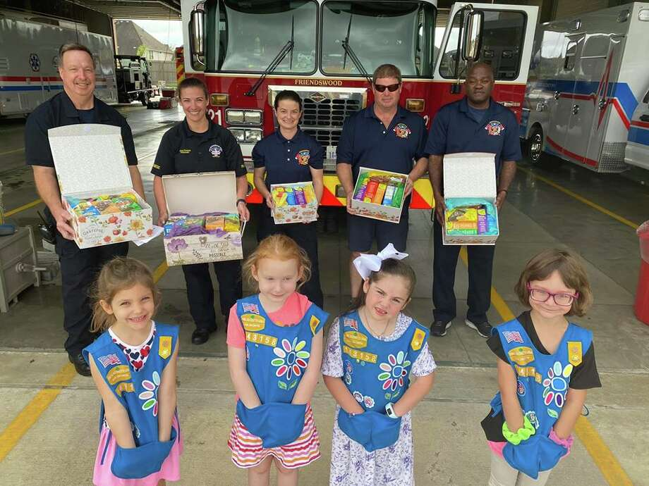 On Wednesday, Friendswood Girl Scout Troop #143158 donated cookies to first responders to thank them for their service during these trying times. According to a Facebook post by the City of Friendswood, the scouts practiced social distancing, and kept their hands in their pockets. Photo: City Of Friendswood/Facebook