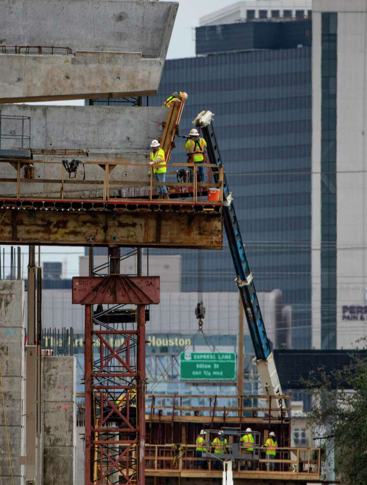Work continues on pylons that will carry connectors between Loop 610 northbound and Interstate 69 northbound on Jan. 29, 2020, in Houston.