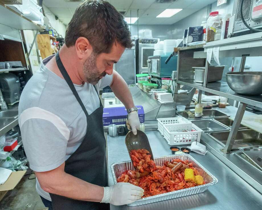 Owner Frankie Randazzo puts together an order of crawfish for a call-in order on March 19, 2020. Madison's on Dowlen Road began offering bulk orders of meat and other food items to people who can't find it at local stores because of the coronavirus outbreak. Fran Ruchalski/The Enterprise Photo: Fran Ruchalski/The Enterprise / 2019 The Beaumont Enterprise
