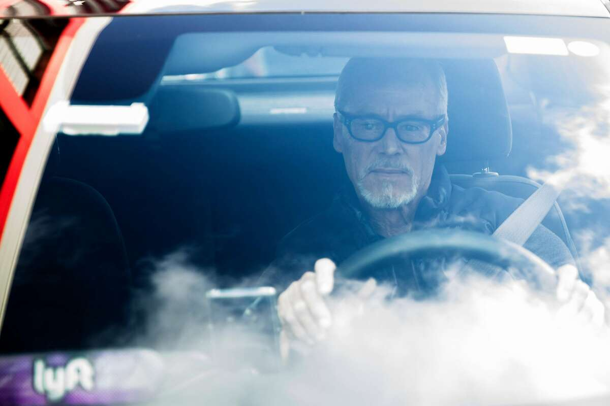 Lyft driver Steven Smith poses for a portrait as he waits to get a call from a passenger in San Francisco, Calif. Thursday, March 19, 2020. Smith and other Lyft drivers have seen a decline in ridership amidst the Bay Area's shelter-in-place in response to the global outbreak of the Coronavirus.