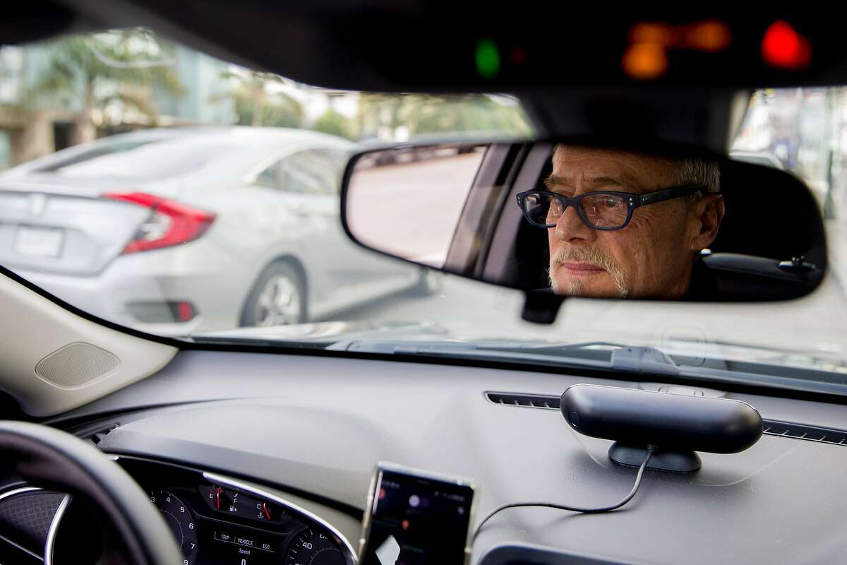 Lyft driver Steven Smith waits to get a call from a passenger in San Francisco, Calif. Thursday, March 19, 2020. Smith and other Lyft drivers have seen a decline in ridership amidst the Bay Area's shelter-in-place in response to the global outbreak of the Coronavirus.