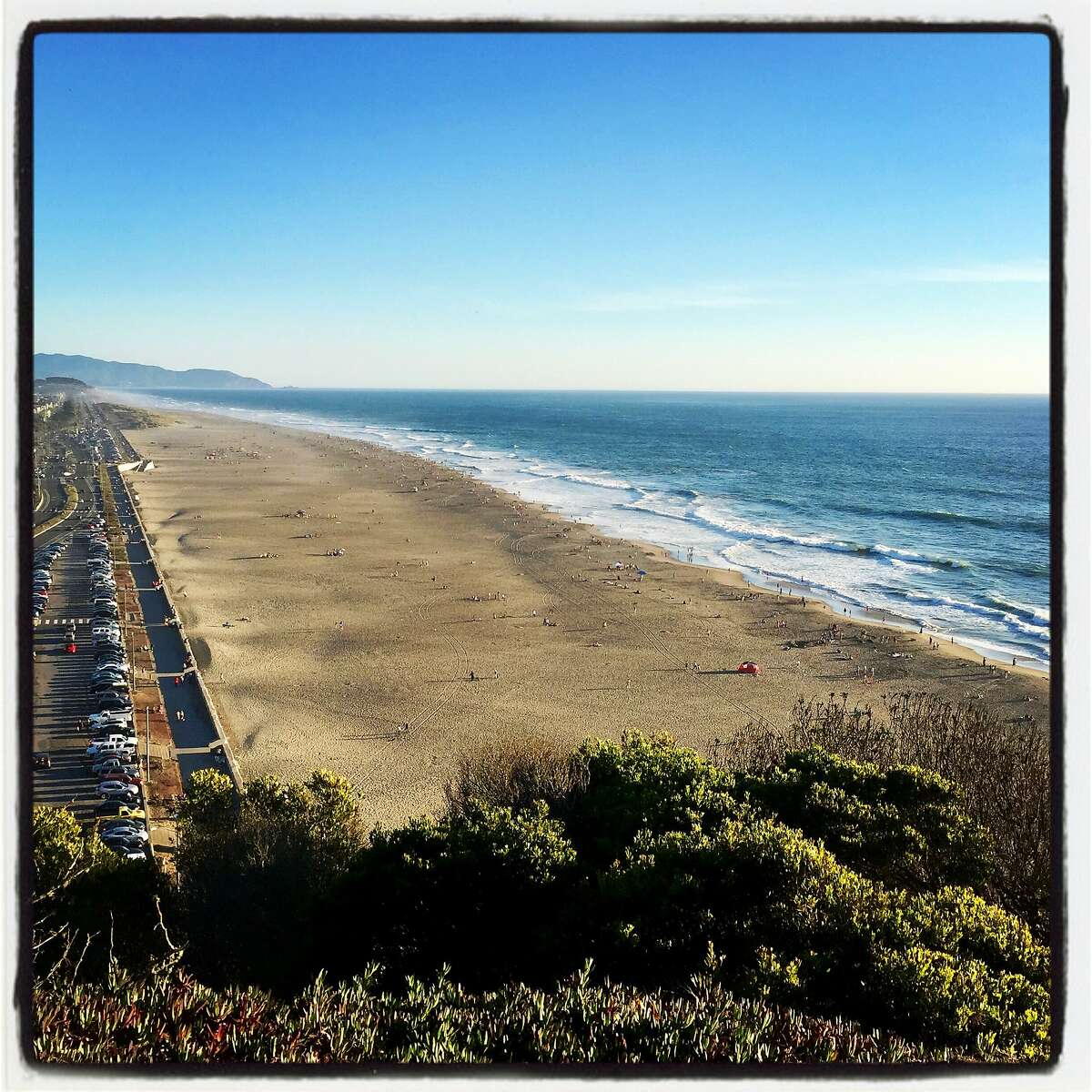 Get some fresh air, amid approved social-distancing space, at Ocean Beach. March 22, 2020.
