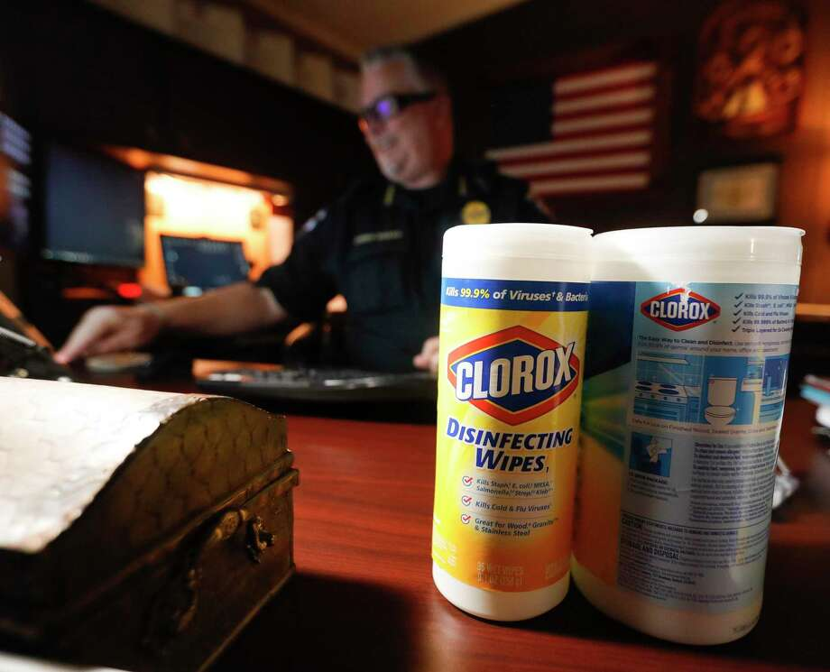 Containers of disinfecting wipes are seen on the desk of Patton Village Police Chief Shannon Sharp, Thursday, March 19, 2020, in Patton Village. Several law enforcement agencies received wipes and other sanitization supplies from residents after a social media post. Photo: Jason Fochtman, Houston Chronicle / Staff Photographer / Houston Chronicle  © 2020