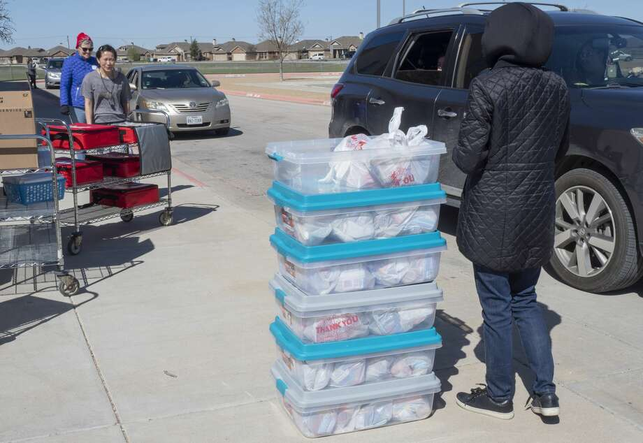For those without internet access, hard copies can be picked up from meal distribution sites 7:30-8:30 a.m. and 11:30 a.m. to 12:30 p.m. Photo: Tim Fischer/Midland Reporter-Telegram