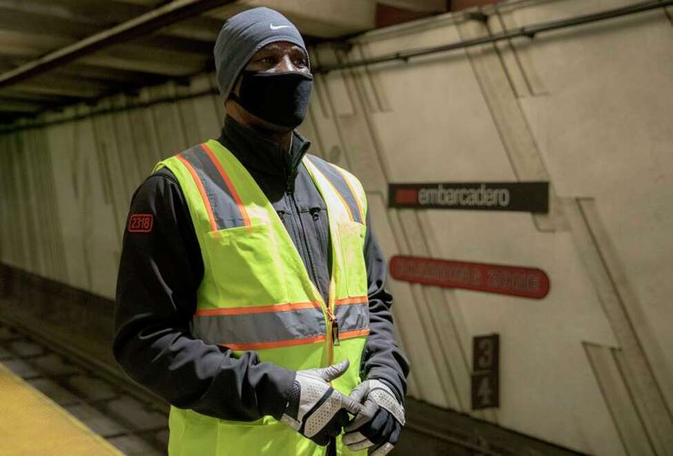 Jacques Anderson, a San Francisco Municipal Transportation Agency operator, wears a mask on a Muni platform. CDC says only health workers and patients need masks.
