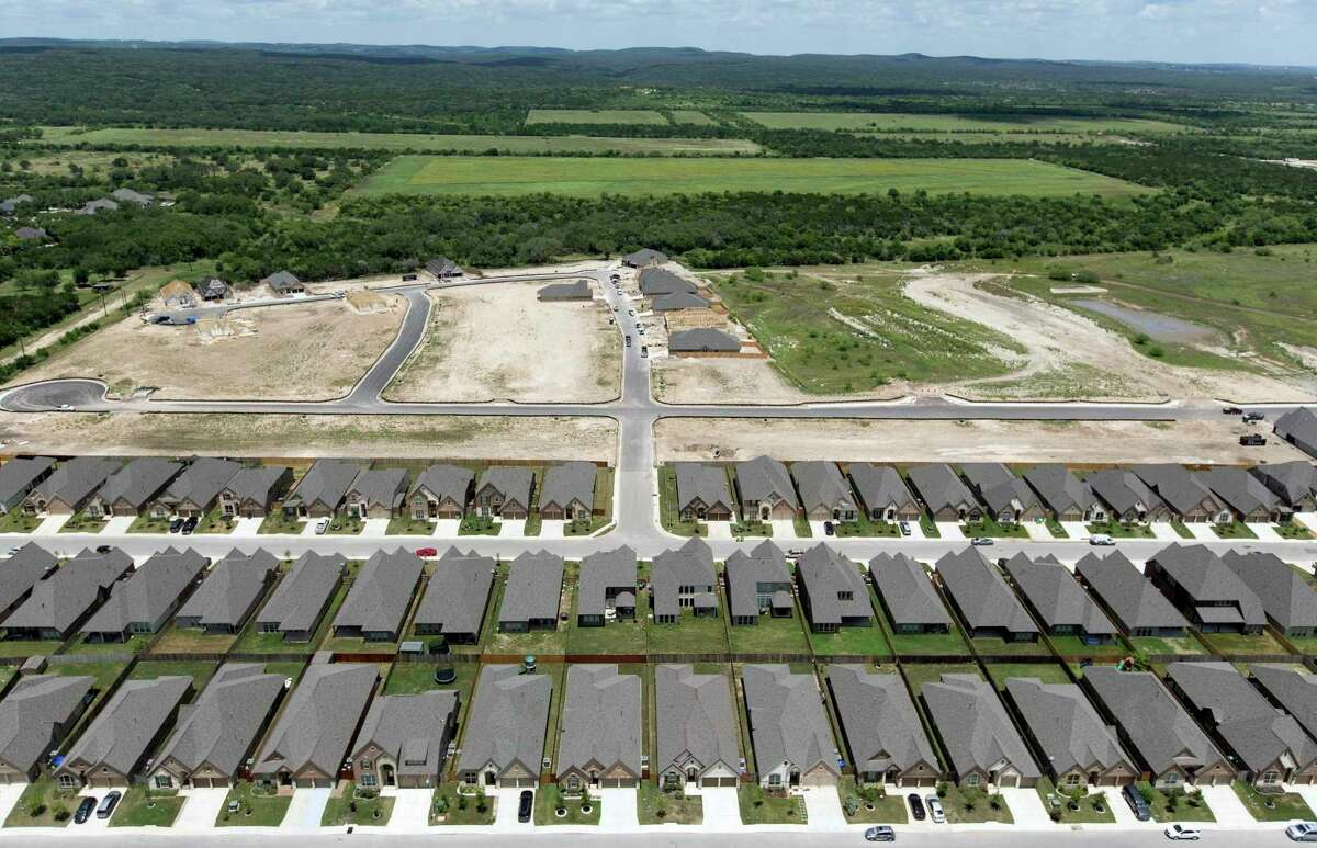 Rows of completed homes stand Wednesday, May 23, 2018 next to another development under construction on San Antonio's West Side north of Culebra Road and west of Loop 1604. Officials with San Antonio and Bexar County plan to ask Gov. Greg Abbott to freeze property values for a year in the wake of the coronavirus pandemic.