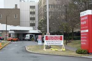 """A sign reading """"RESTRICTED VISITATION"""" is seen outside the main entrance of Samaritan Albany Memorial Hospital on Friday, Mar. 20, 2020 in Albany, N.Y. (Jenn March, Special to the Times Union)"""