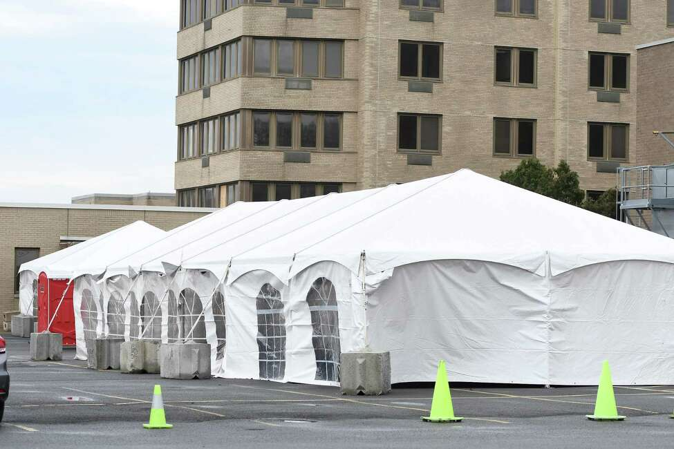 Tents set up for COVID-19 screening are seen behind Samaritan Albany Memorial Hospital on Friday, Mar. 20, 2020 in Albany, N.Y. (Jenn March, Special to the Times Union)