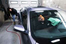 Mohawk Honda automotive reconditioning specialists, Therese Densmore, left, and Tom Fleming, detail a customer's car on Monday, March 9, 2020, in Scotia, N.Y. (Paul Buckowski/Times Union)