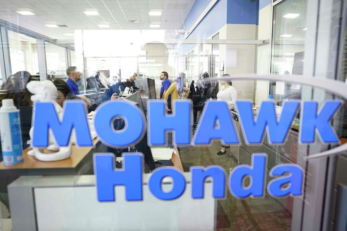 Mohawk Honda employees work at the car dealership on Monday, March 9, 2020, in Scotia, N.Y. (Paul Buckowski/Times Union)