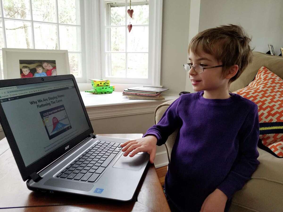 Ryland Hunt, 9, works on his website,