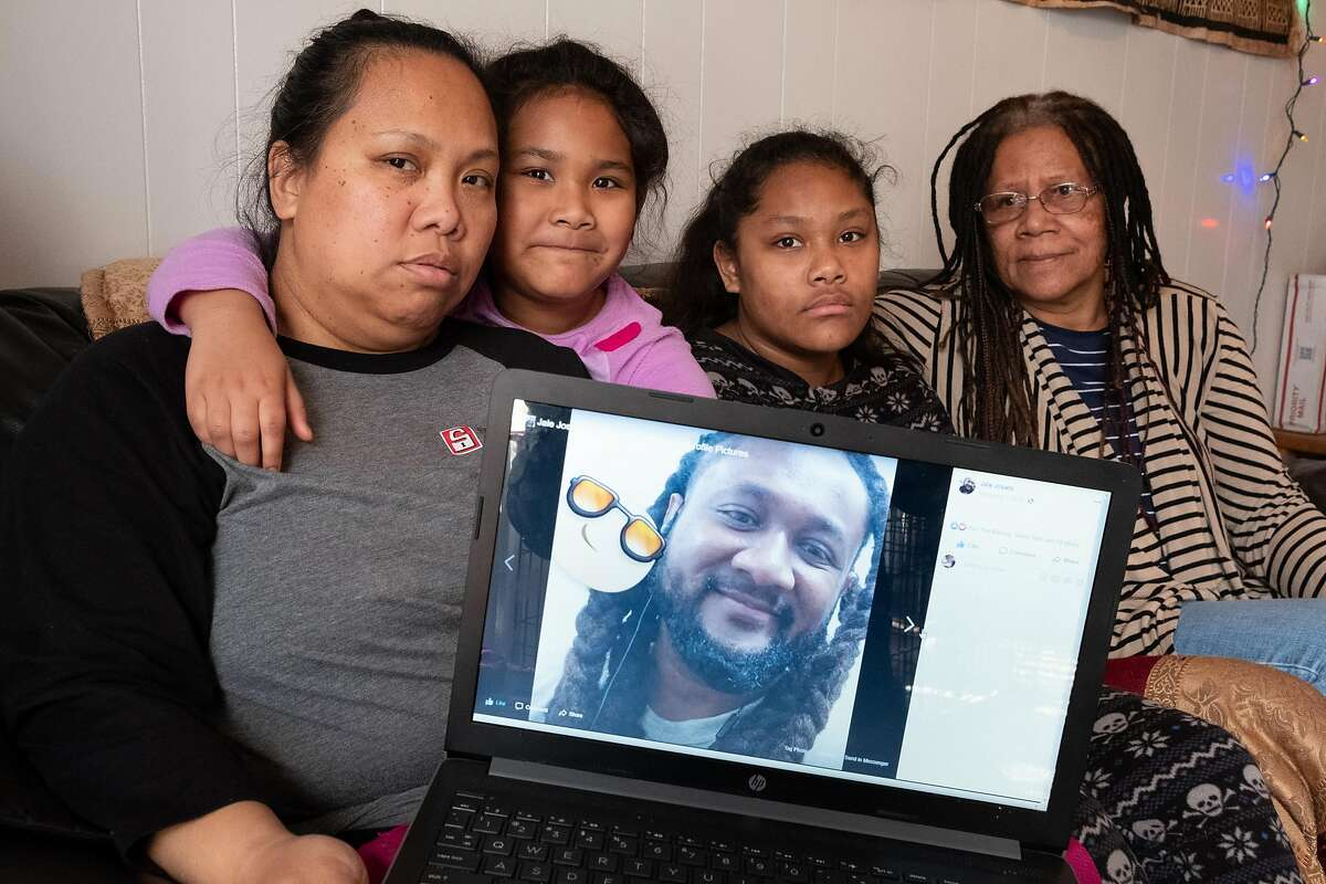 The family of Charles Joseph � his wife Shelly Clements, daughters Carly, 7, and Hope, 12, and his mother Alumita Siva, display a photo of him on a Facebook page in their apartment in Sacramento, Wednesday, January 29.