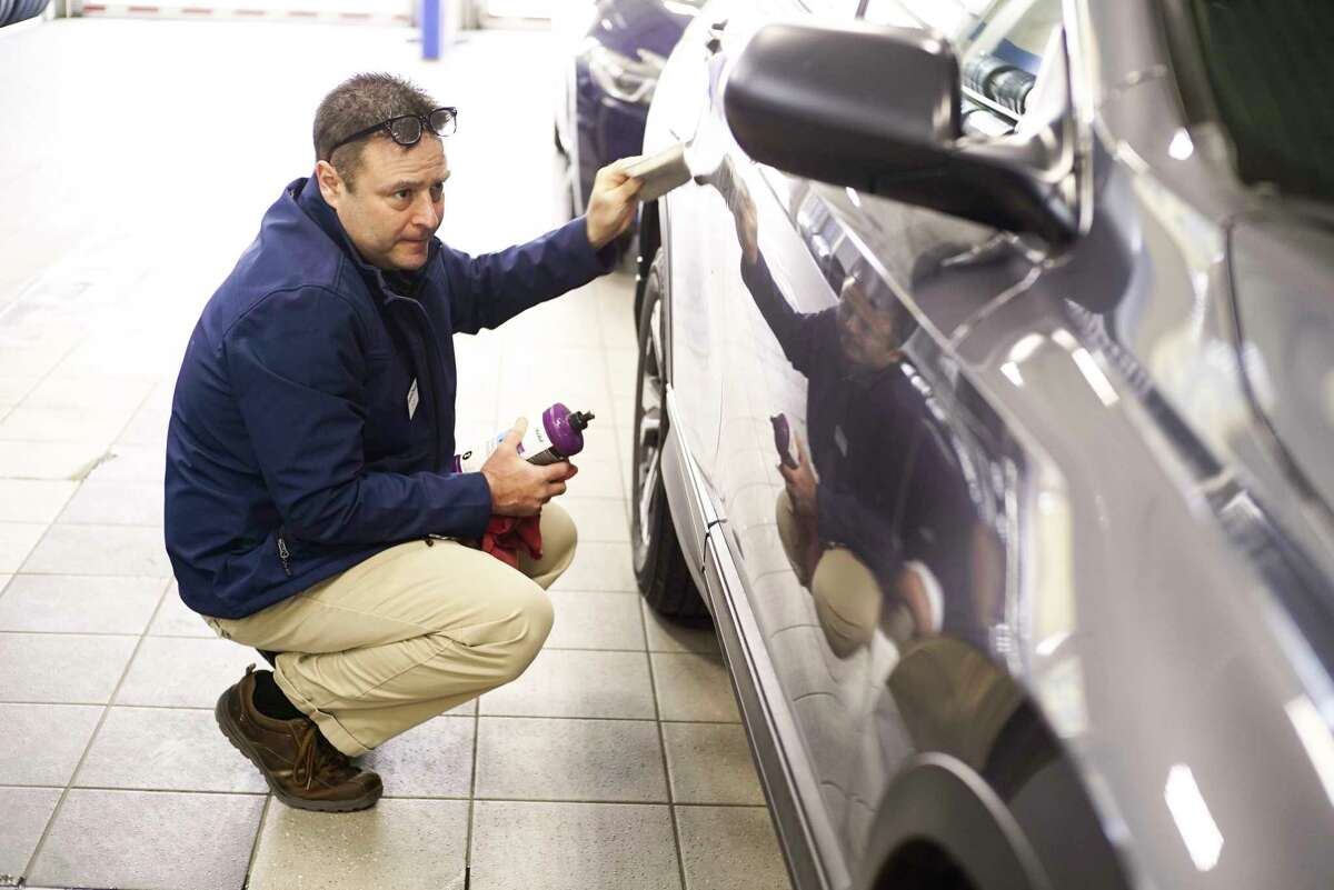 Mohawk Honda service advisor, Peter Perry, works to remove a scratch from a customer's vehicle at the car dealership on Monday, March 9, 2020, in Scotia, N.Y. (Paul Buckowski/Times Union)