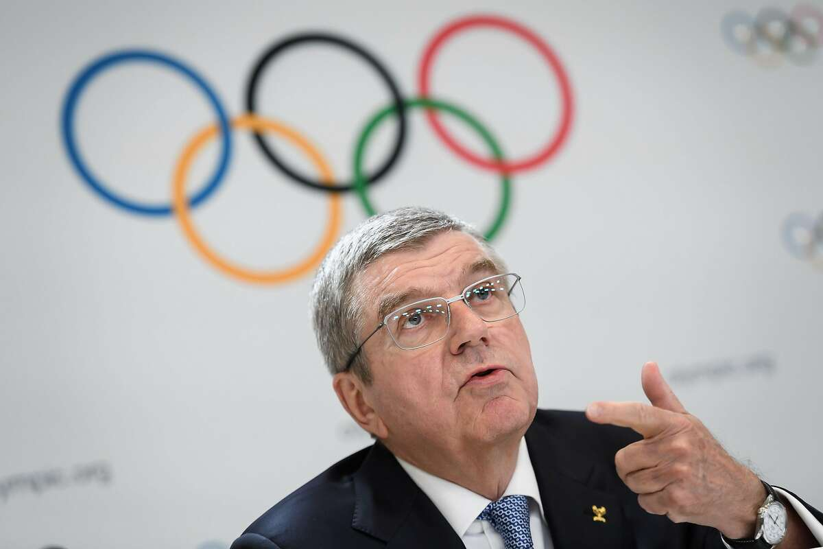 (FILES) In this file photo taken on January 11, 2020 International Olympic Committee (IOC) President Thomas Bach attends a press conference closing an Olympic session in Lausanne. - Bach said on March 20, 2020 the organisation was
