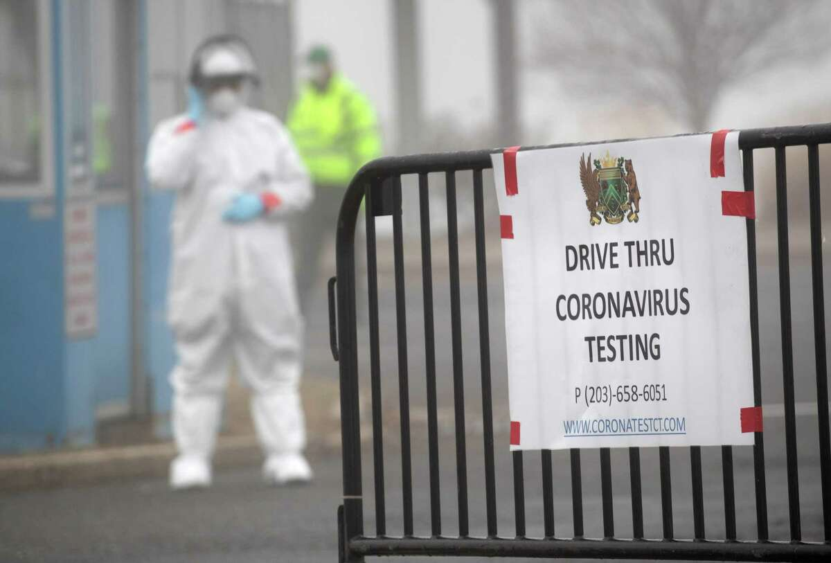 A sign sits on a barrier at a coronavirus (COVID-19) drive thru testing location operated by Murphy Medical Associates at Cummings Park on March 20 in Stamford. Communities throughout the United States have begun opening drive-thru sites to test people feeling potential symptoms of COVID-19 and have a doctor's referral.
