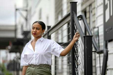 """Ruby Amare, founder of Wonderlikewander, poses for a portrait near her shop Thursday, March 19, 2020, in Houston. """"I'm a Houston creative who wants to create opportunities for other creatives to connect and grow together,"""" she said."""