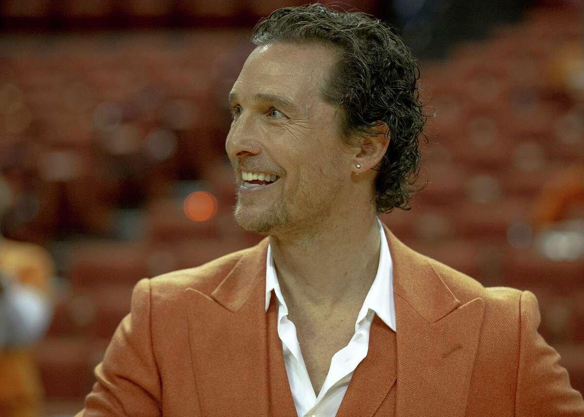 Actor Matthew McConaughey smiles before an NCAA college basketball game between Texas and Oklahoma on Saturday, Jan. 19, 2019, in Austin, Texas. He announced an upcoming virtual benefit to help Texans in need after a winter storm left millions without power and water last week. (Nick Wagner/Austin American-Statesman via AP)