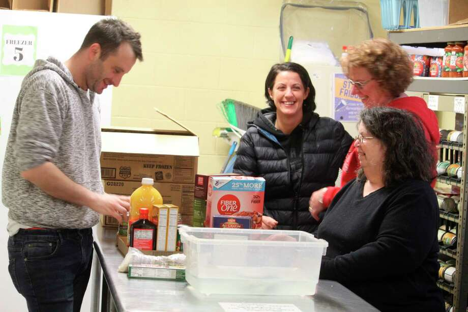 Staff and volunteers with Project Starburst are working hard to ensure families in Mecosta and Osceola counties have food on their tables as many businesses are closed due to concerns of the coronavirus. (Pioneer photo/Catherine Sweeney)
