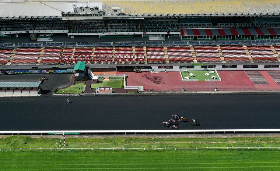 BERKELEY, CALIFORNIA  - MARCH 19: Horse racing continues at Golden Gate Fields with no fans in attendance due to coronavirus concerns on March 19, 2020 in Berkeley, California. As millions of people in the San Francisco Bay Area are under a shelter-in-place order due to COVID-19, horse racing at Golden Gate Fields continues but the events are not open to the public. (Photo by Justin Sullivan/Getty Images) Photo: Justin Sullivan / Getty Images