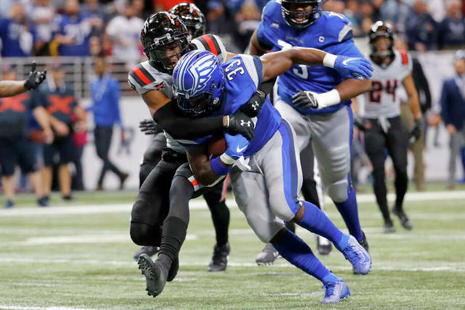 St. Louis Battlehawks running back Christine Michael (33) runs through a tackle attempt by New York Guardians safety A.J. Hendy (33) during a game in St. Louis. The XFL has cancelled the rest of the reason because of the coronavirus spread. Photo: Billy Hust File | For The Telegraph