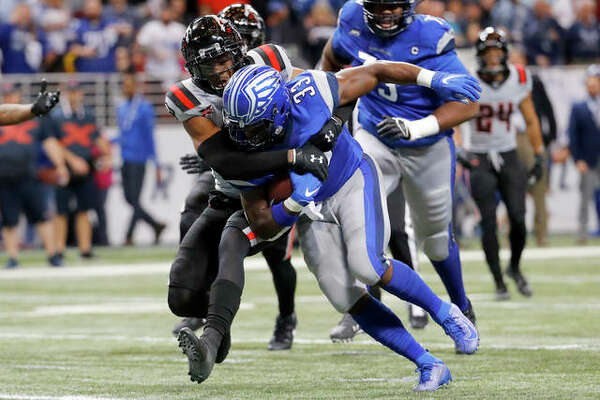 St. Louis Battlehawks running back Christine Michael (33) runs through a tackle attempt by New York Guardians safety A.J. Hendy (33) during a game in St. Louis. The XFL has cancelled the rest of the reason because of the coronavirus spread.