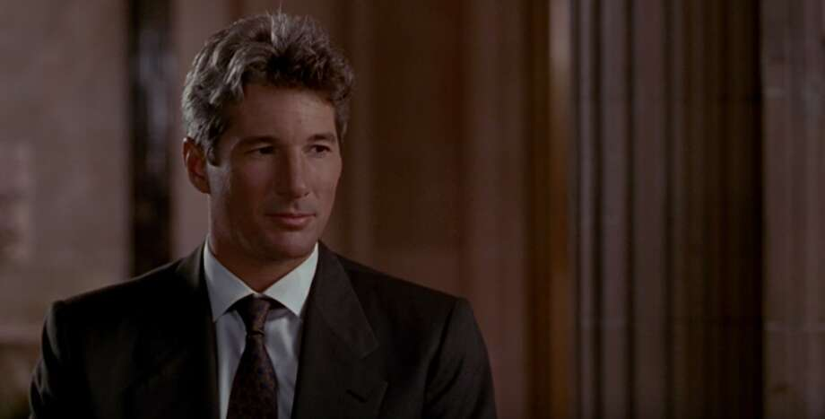 """Richard Gere Richard Gere established his pedigree as Hollywood A-list material in critically acclaimed '80s films like """"Days of Heaven"""" and blockbuster early '80s movies like """"An Officer and a Gentleman."""" His performance in """"Pretty Woman"""" played to type: three-piece suits, calm, collected business dealings and unstoppable charisma. Also interesting to note, he didn't always have grey hair. Photo: Touchstone Pictures"""