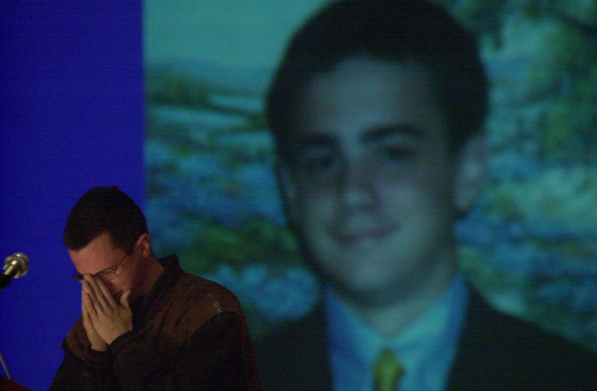 Speaking in front of an image of his debate mate Ryan Hastings, David Cruz, 18, of San Antonio broke down during a slide show of Hastinfgs life during a memorial service at Taft High School in Sa Antonio Sunday afternoon. Hastings died in a car accident last month. (San Antonio Express News Photo By Maria J. Avila)