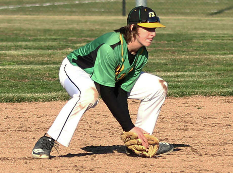 Southwestern's Jarrett Dresch fields a groundball at shortstop during a game last season in a game at the Bethalto Sports Complex. Dresch will shift to second base for the Piasa Birds this season. Photo: Greg Shashack | The Telegraph