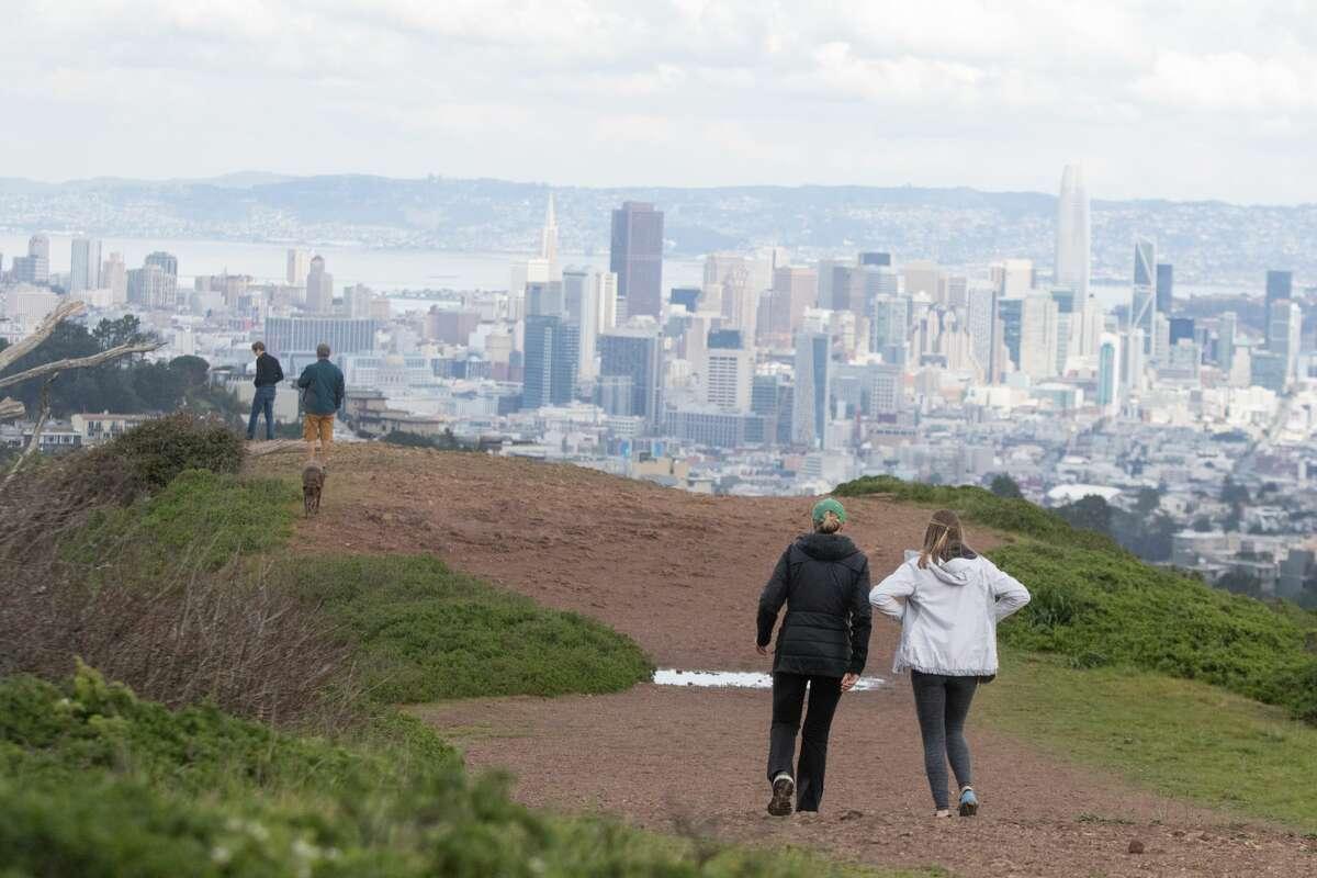 People hiking on Mount Davidson.