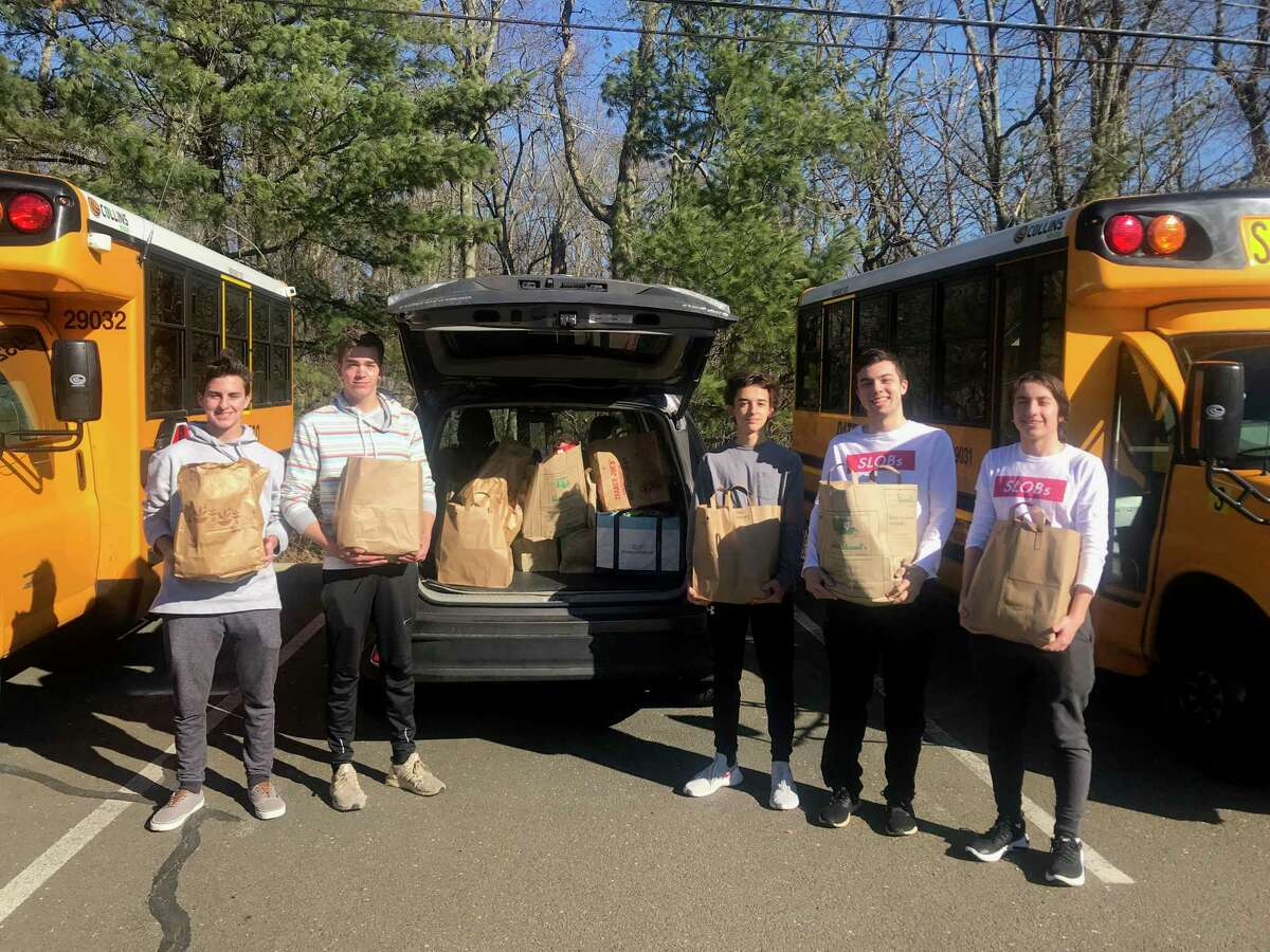 New Canaan High School Service League of Boys (SLOBs) members Ashton Healey, Douglas Gillespie, Justin Generalis, Will Galvan and Payton Welch.