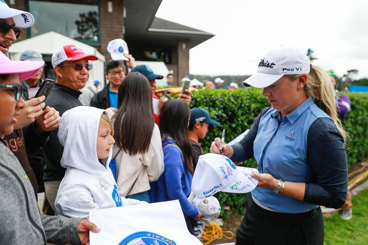 Bronte Law, of England (right) signs autographs after finishing the course in the lead at Lake Merced Golf Club during the final round of the LPGA Mediheal Championship golf tournament in Daly City, California, on Sunday, May 5, 2019.