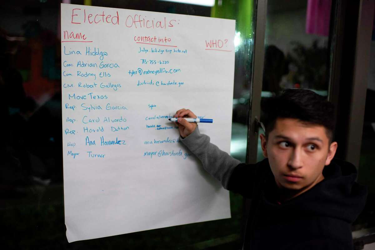 Volunteer Michael Garza makes a list of government officials to invite to an upcoming block party at the headquarters of Jolt, a non-profit organization that works to increase the civic participation of Latinos in Texas, in Houston, Texas on February 20, 2020. - US census data shows that Texas's Hispanic population grew from 9.5 to 11.4 million between 2010 and 2018, and is on track to become the largest population group in the state by 2022. That mirrors the trend nationwide where a record 32 million Latinos are projected to be eligible to vote in 2020, surpassing blacks as the largest minority group in the electorate, according to Pew Research. That is a four million increase since 2016. But turnout has been a persistent challenge: since 1996, Pew data shows that most eligible Latinos have not cast ballots in US presidential elections. (Photo by Mark Felix / AFP) (Photo by MARK FELIX/AFP /AFP via Getty Images)