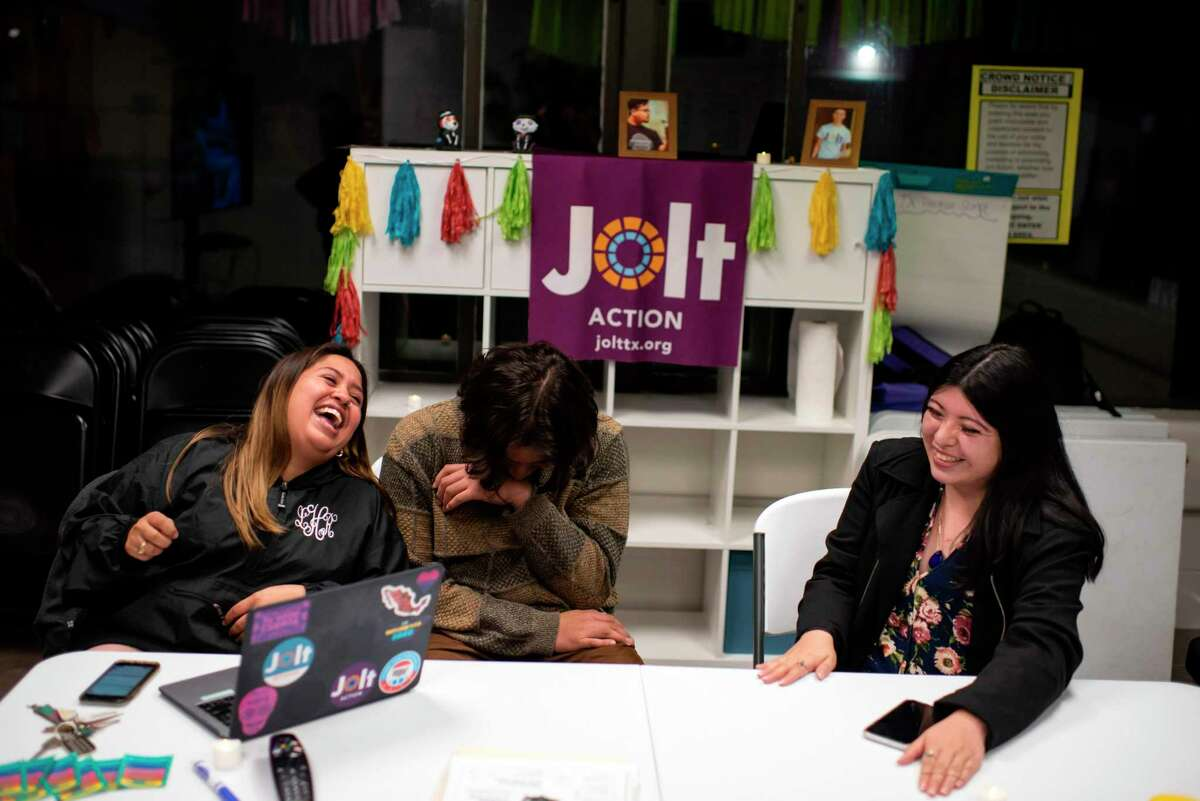 Jolt Census Organizer Leslie Hernandez (L) shares a laugh with volunteers Carlos Ramirez (C) and Marlen Guerrero at the headquarters of Jolt, a non-profit organization that works to increase the civic participation of Latinos in Texas, in Houston, Texas on February 20, 2020. - US census data shows that Texas's Hispanic population grew from 9.5 to 11.4 million between 2010 and 2018, and is on track to become the largest population group in the state by 2022. That mirrors the trend nationwide where a record 32 million Latinos are projected to be eligible to vote in 2020, surpassing blacks as the largest minority group in the electorate, according to Pew Research. That is a four million increase since 2016. But turnout has been a persistent challenge: since 1996, Pew data shows that most eligible Latinos have not cast ballots in US presidential elections. (Photo by Mark Felix / AFP) (Photo by MARK FELIX/AFP /AFP via Getty Images)
