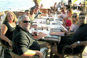 Sam Guarino, foreground, dining out on vacation with his favorite people - his family.