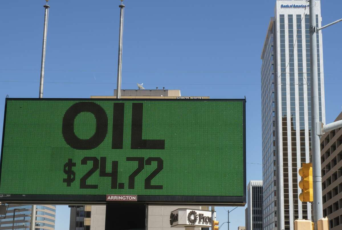 Friday's oil price is posted on a sign in Midland, Texas.