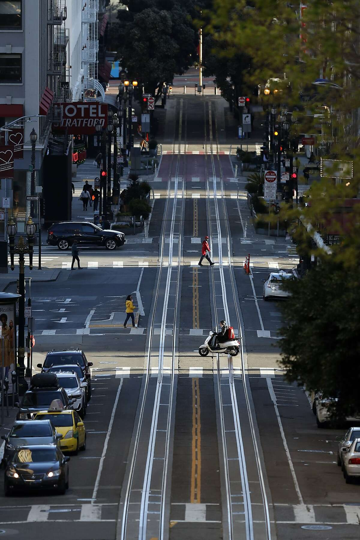 During what normally would be rush hour, vehicular traffic on Powell Street is nearly non-existent during coronavirus shelter in place in San Francisco, Calif., on Thursday, March 19, 2020.