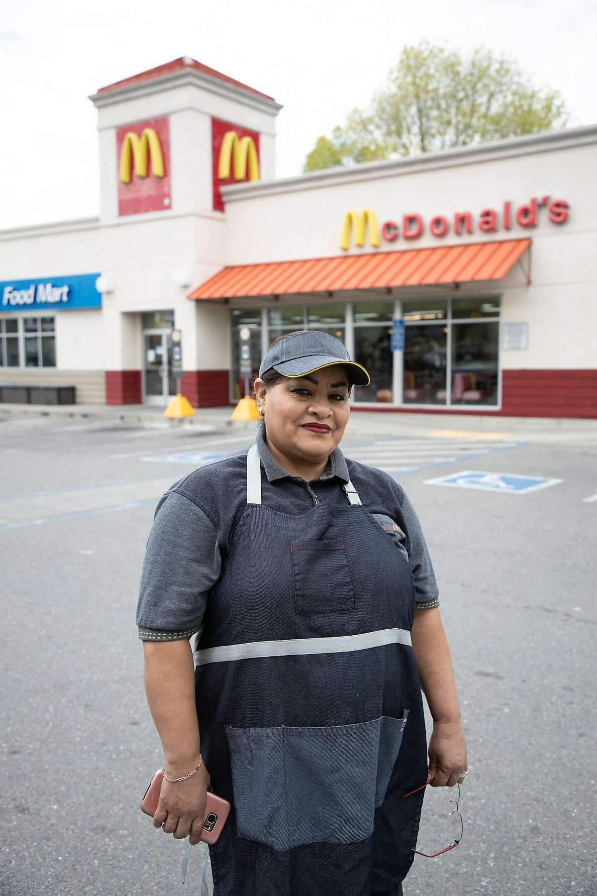 Ana Martinez poses for a portrait during a work break at McDonald's Friday, March 20, 2020, in Milpitas, Calif. She doesn't get health insurance through McDonald's. She has some insurance from her husband's job at Kellogg's cereal, but worries it is not enough and the out of pocket costs are high.