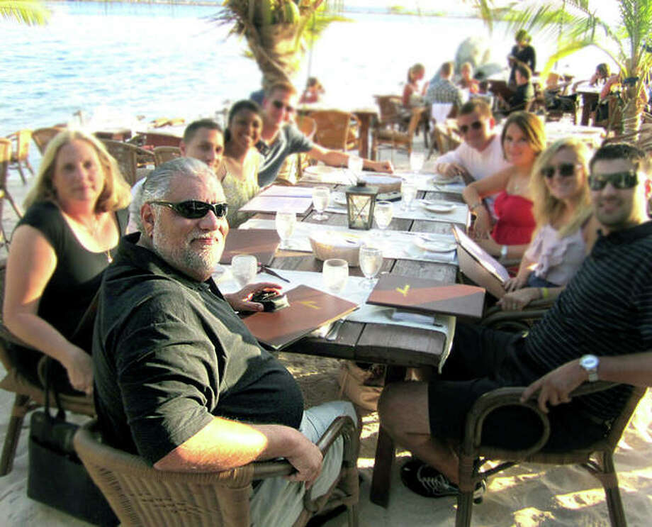 Sam Guarino, foreground, dining out on vacation with his favorite people - his family. Photo: Submitted Photo