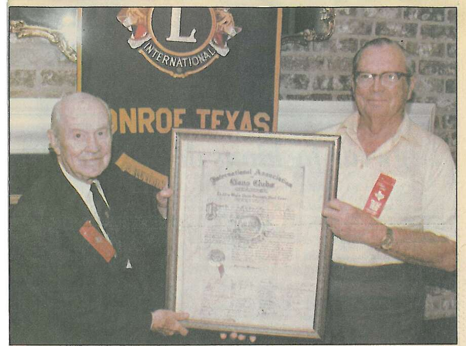 In 1989, the Conroe Noon Lions Club celebrated its 50th Anniversary, holding the original club charter are charter members George Darden(l) and Dr. Paul Hicks(r); the club just recently celebrated its 80th year. Photo: Courtesy Photo