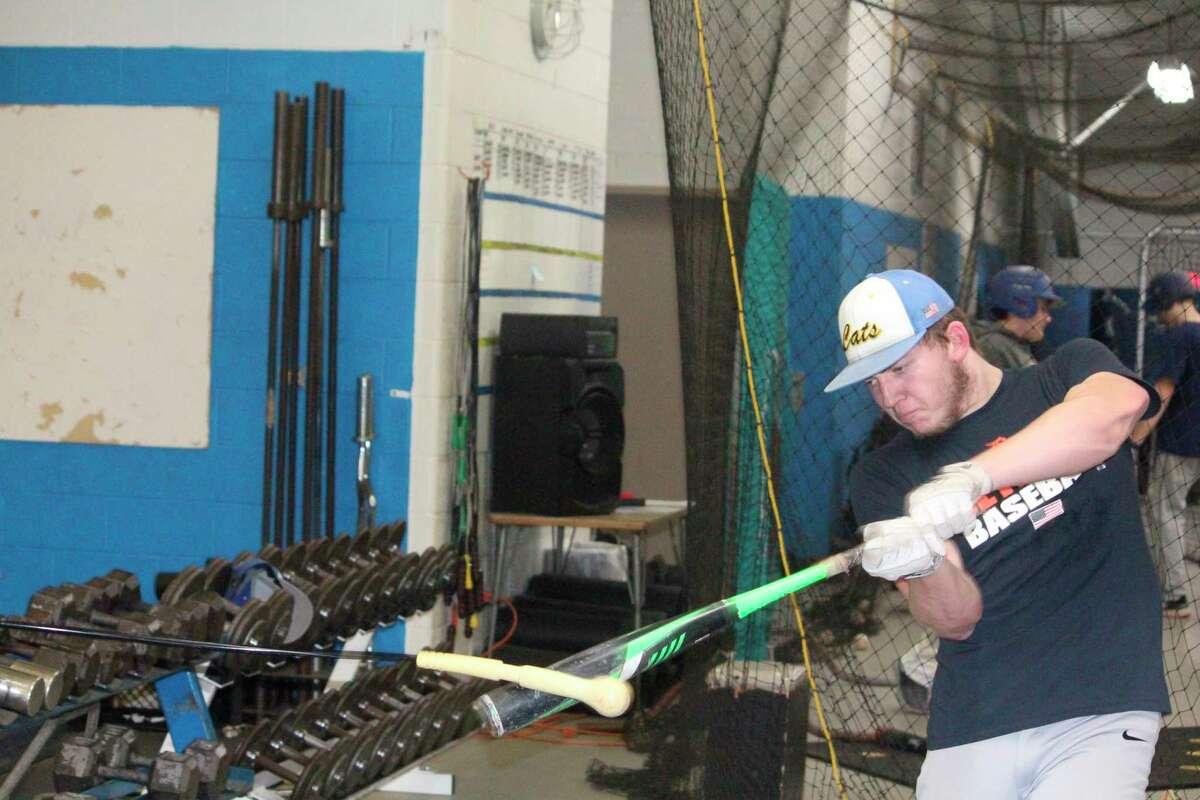Justin O'Dell works on his hitting last week at an Evart practice. (Pioneer photo/John Raffel)