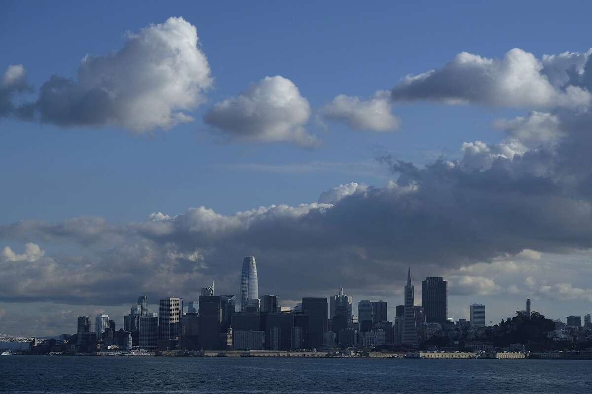 Clouds form above the San Francisco skyline in this view from a Golden Gate Ferry Monday, March 16, 2020, in San Francisco. Officials in seven San Francisco Bay Area counties have issued a shelter-in-place mandate affecting about 7 million people, including the city of San Francisco itself. The order says residents must stay inside and venture out only for necessities for three weeks starting Tuesday. It's the latest effort by officials to curb the spread of the novel coronavirus. (AP Photo/Eric Risberg)