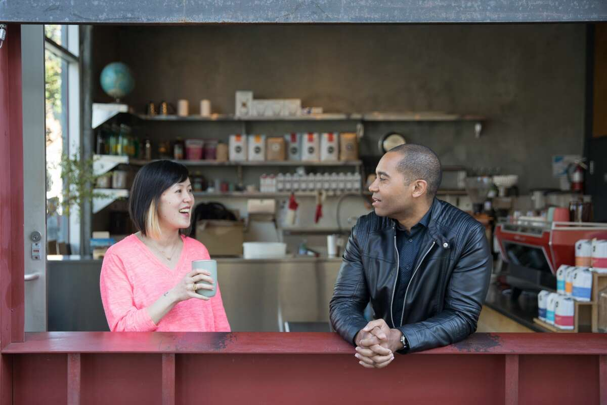 (Left to right) Ken Gwynn and Ziyan C. have had the Yelp Elite status for at least a decade. They were photographed at Linea Cafe in San Francisco, on March 11, 2020.