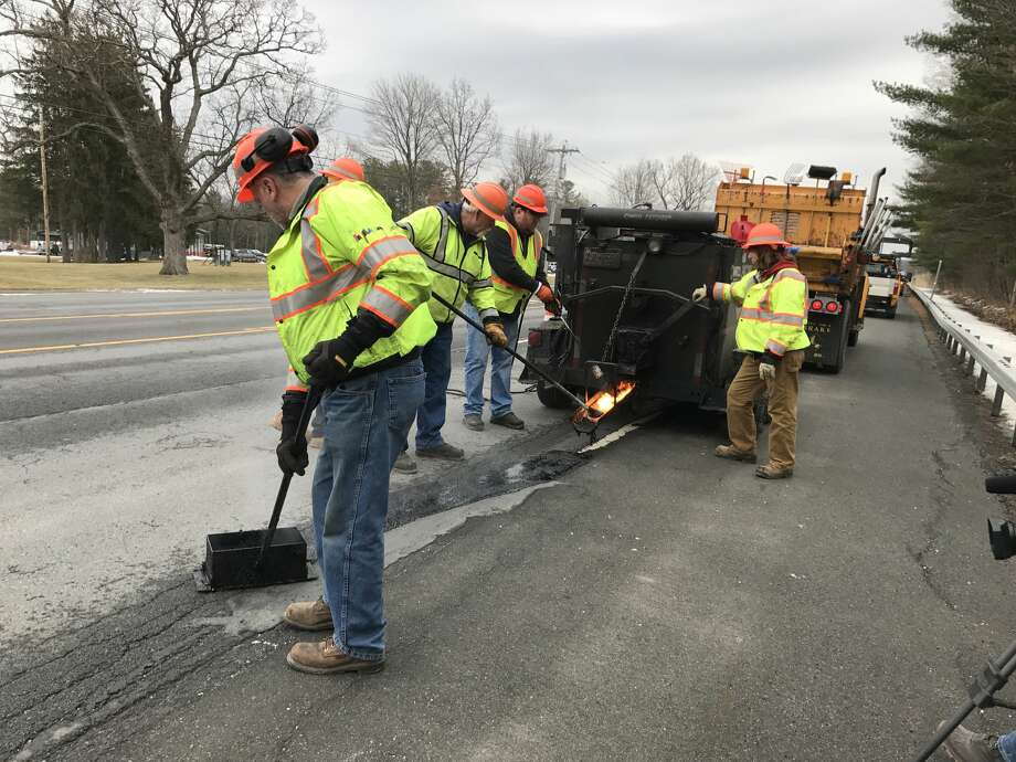 NYS Department of Transportation work crews use mastic to fix potholes on Route 9 near Round Lake in February. Photo: NYS Department Of Transportation