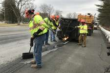 NYS Department of Transportation work crews use mastic to fix potholes on Route 9 near Round Lake in February.