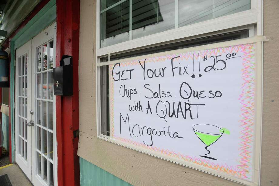 Signage indicates a special at Tia Juanita's in Beaumont on the first day of area restaurant and bar closures.  Photo taken Thursday, March 19, 2020 Kim Brent/The Enterprise Photo: Kim Brent / Kim Brent/The Enterprise / BEN