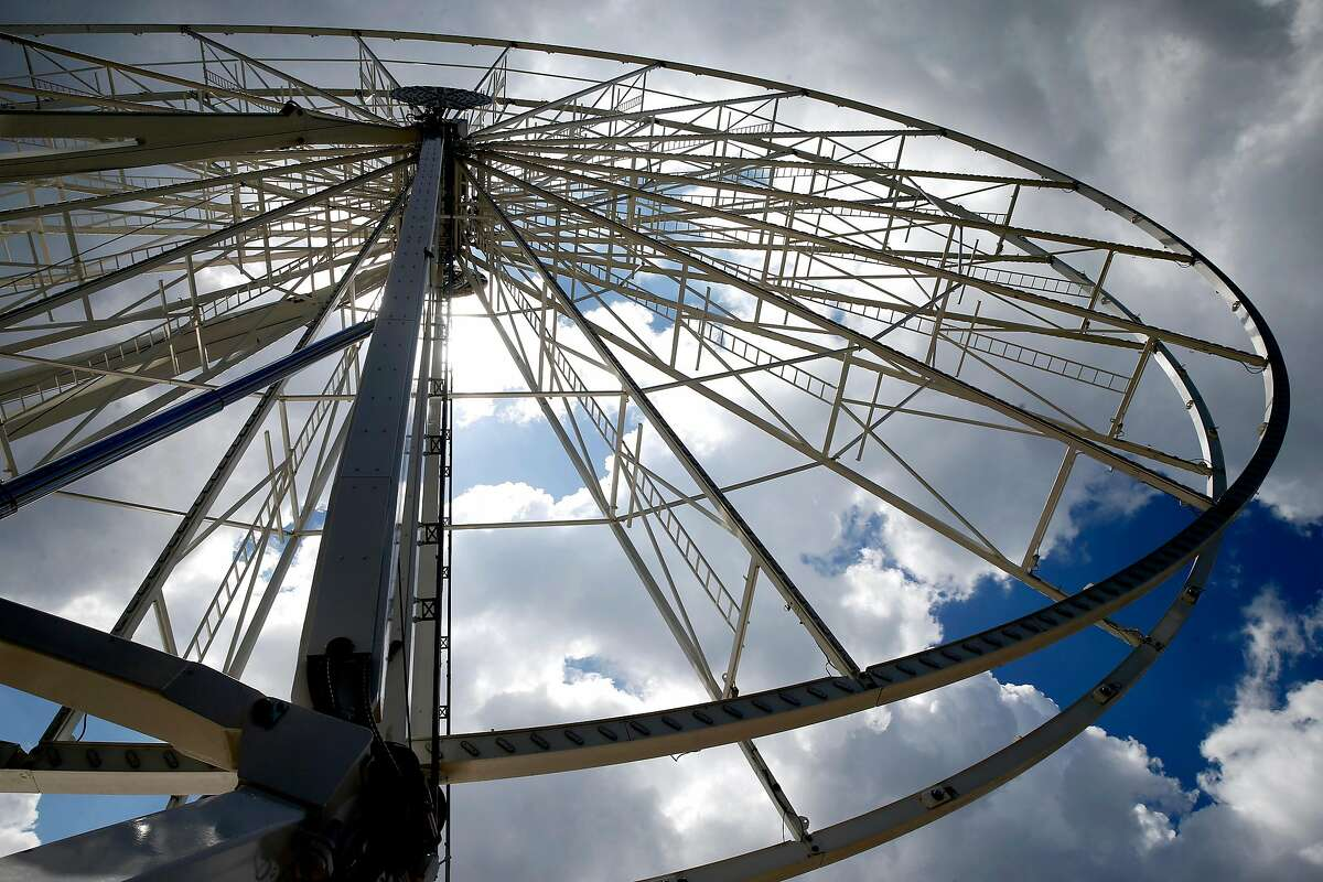 """The 150-foot high SkyStar Ferris wheel is assembled at the eastern end of the Music Concourse at Golden Gate Park in San Francisco, Calif. on Friday, March 20, 2020. The opening of the """"observation"""" wheel, erected to commemorate the 150th anniversary of the park, is being delayed due to the coronavirus pandemic."""
