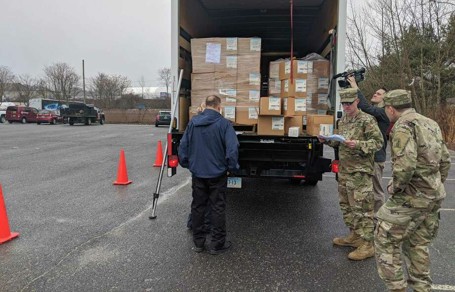 Members of the Connecticut National Guard helped the state Department of Public Health distribute tens of thousands of protective material while dealing with coronavirus Photo: Contributed Photo / Connecticut National Guard