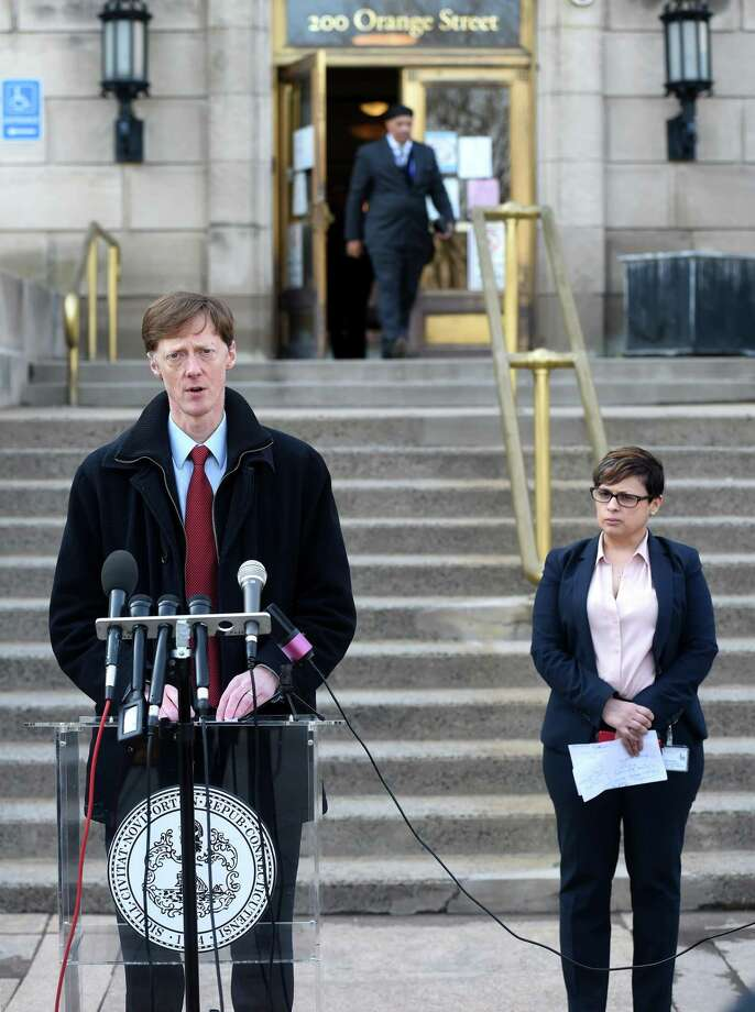 New Haven Mayor Justin Elicker holds a press briefing outside of the Hall of Records in New Haven on March 20, 2020. At right is New Haven Director of Health Maritza Bond. Photo: Arnold Gold / Hearst Connecticut Media / New Haven Register